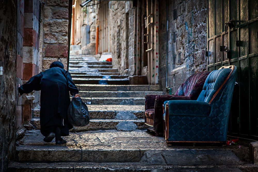 An old lady struggles her way up a steep alley in Jerusalem´s old city. Photo: John EInar Sandvand