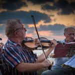 Photographing street musicians on the beach promenade in Tel Aviv