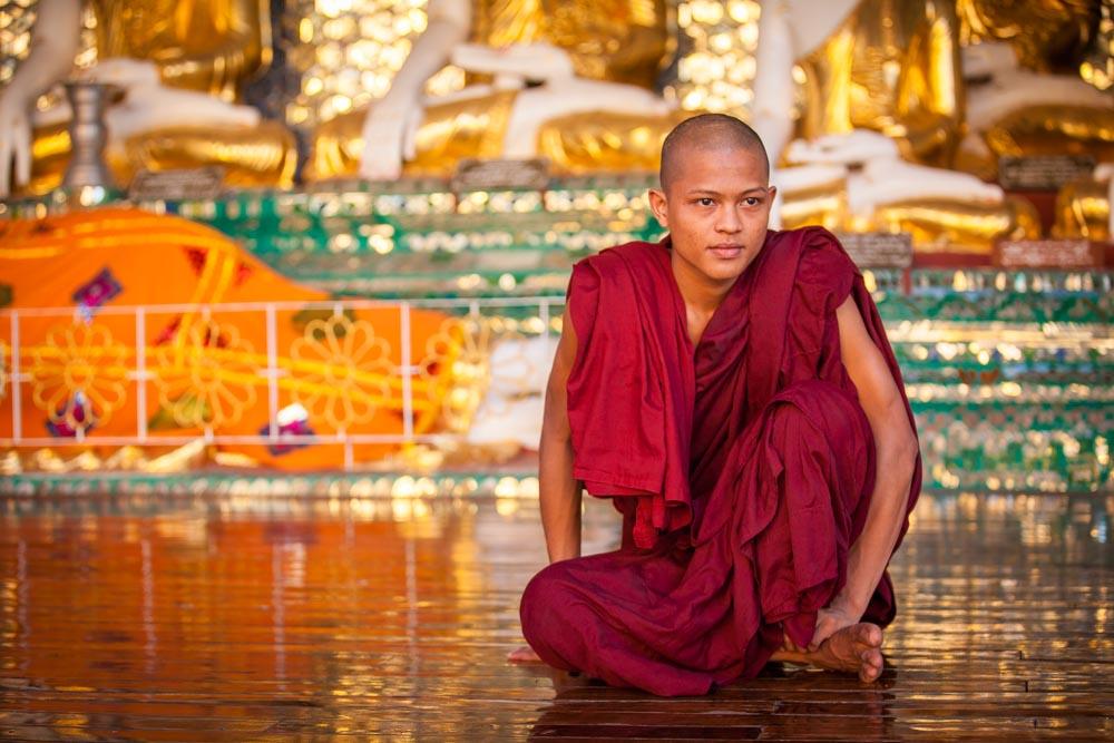 A young monk at Shwedagon pagoda. Photo: John Einar Sandvand